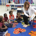 St. Elizabeth's Guild President Cindy Wooderson shares a story-time with the children of St. John Head Start - a small example of the many blessings the ladies of St. Elizabeth's Guild have shared with our Head Start children!